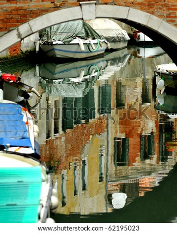 Reflections in one of Venice's canals - stock photo