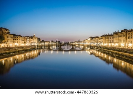 reflections in the arno river in florence - stock photo
