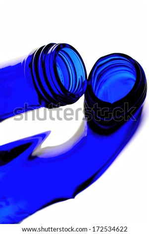 Reflections  of a cobalt blue bottle.