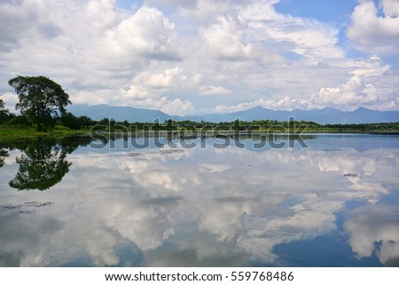 Reflections of blue sky on the lake for background.