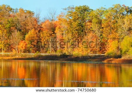 Reflections of brilliant autumn colors in a serene lake (Punderson Lake in northeast Ohio)