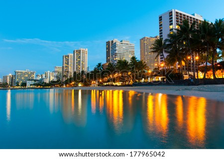 Reflections of buildings at Waikiki in the water. - stock photo