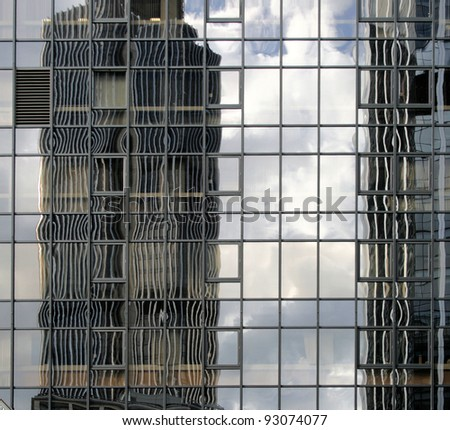 Reflections of Glass in Glass building - stock photo