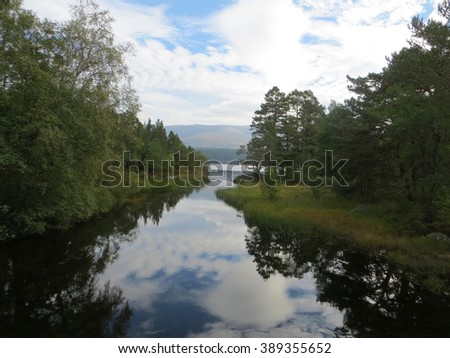 Reflections of Loch Morlich - stock photo