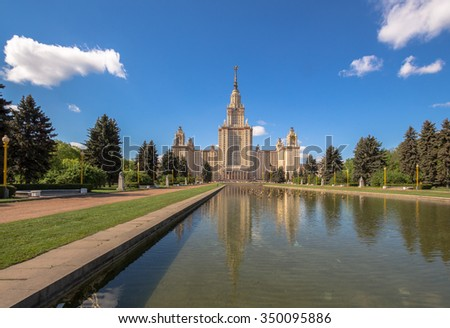 Reflections of Moscow State University main building in fountain cascade pool in sunny summer day