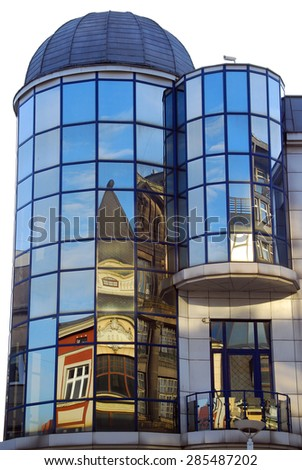 reflections of old building in windows on Piotrkowska street in Lodz,Poland - stock photo