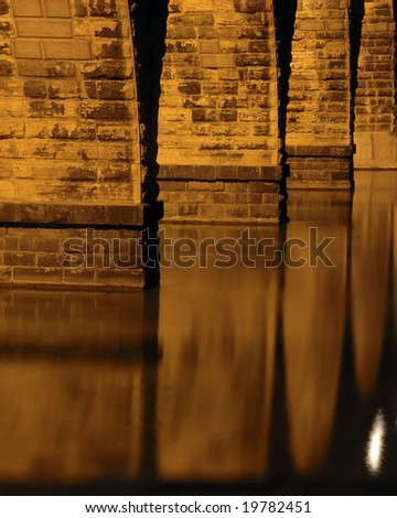Reflections of Stone Arch Bridge, Minneapolis, MN - stock photo