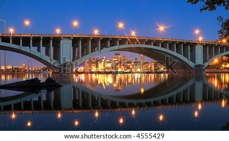 Reflections on Mississippi River - 3rd Avenue Bridge - Minneapolis, MN - stock photo