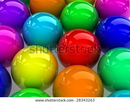 reflective colorful balls on gray background.