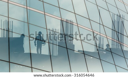 Reflective glass building of worker construction.