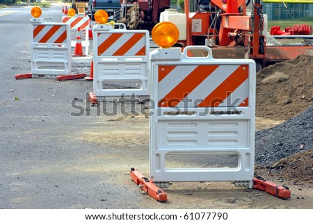 Reflective safety traffic barriers at road highway construction site for a temporary detour during street work improvement