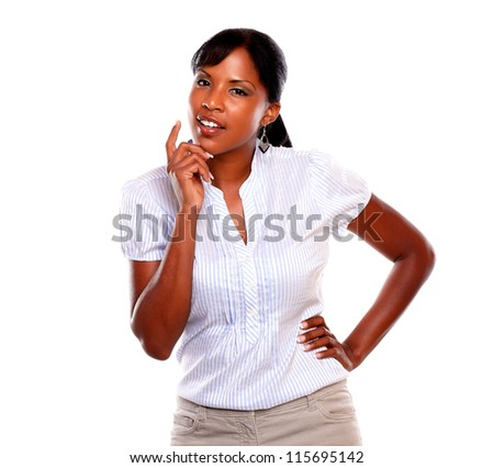 Reflective young woman looking at you against white background