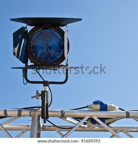 Reflector in an outdoor theater with blue sky background - stock photo