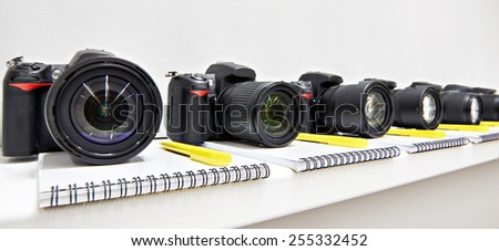Reflex digital cameras with notepad in the classroom photo-school - stock photo