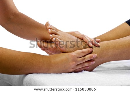 Reflexology foot massage - stock photo