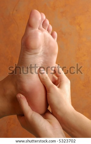 Reflexology Foot Massage At Spa - stock photo