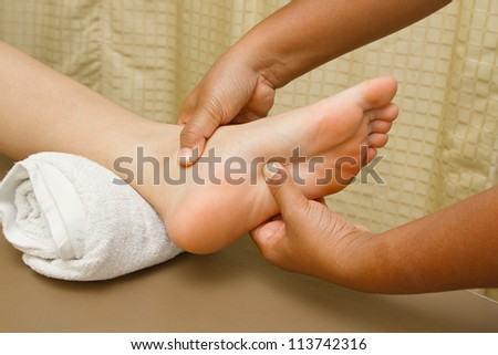reflexology foot massage, foot spa treatment - stock photo