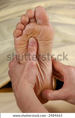 Reflexology Foot Massage Sole and Heel - stock photo