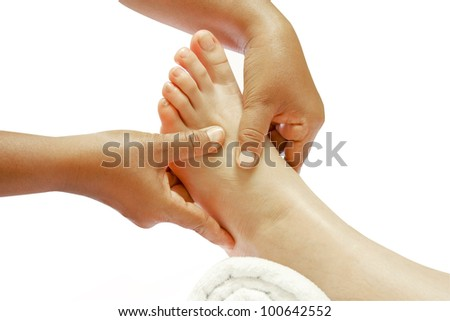 reflexology foot massage, spa foot treatment - stock photo