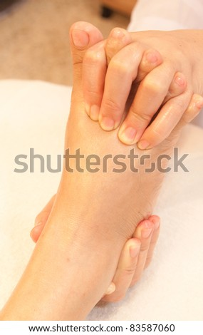 reflexology foot massage, spa foot treatment,Thailand - stock photo