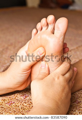 reflexology foot massage, spa foot treatment,Thailand - stock photo