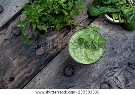 refreshing and detoxifying drink  derived from  plants and vegetables green  leaves - stock photo
