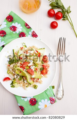 Refreshing and healthy quinoa salad with zucchini and tomatoes - stock photo