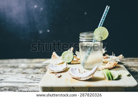 refreshing chilled coconut water with lime wedges