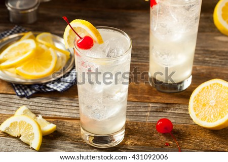 Refreshing Classic Tom Collins Cocktail with a Cherry and Lemon Slice - stock photo