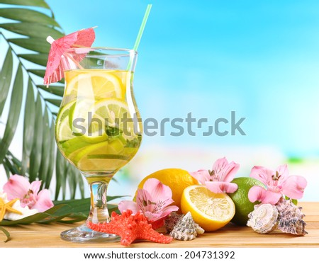 Refreshing cocktail on beach table