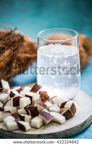 refreshing coconut water with pupl, vibrant colors and summer drink concept - stock photo