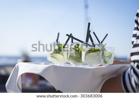 Refreshing drinks on a tray - stock photo