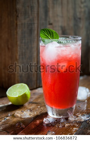 refreshing fruit punch beverage in glass on wooden background