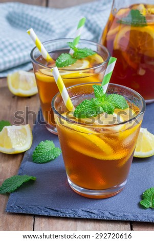 Refreshing homemade lemon iced tea on a black slate tray