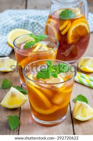 Refreshing homemade lemon iced tea on a wooden table - stock photo