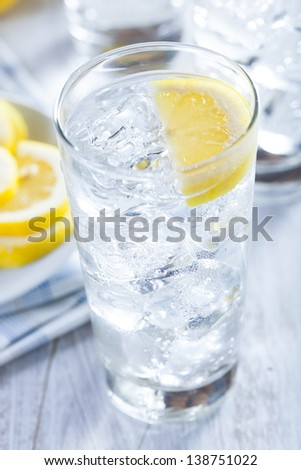 Refreshing Ice Cold Water with Lemon ready to drink - stock photo