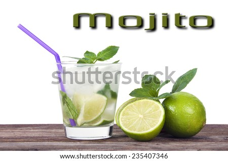 Refreshing iced rum, lime and mint mojito cocktail on an old wooden board - stock photo