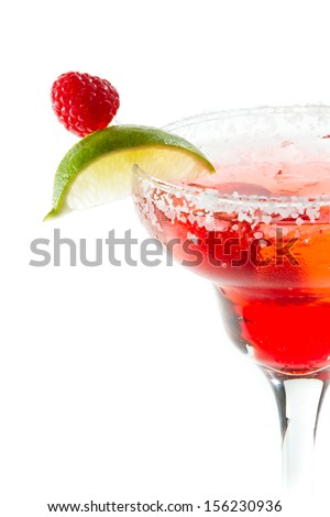refreshing raspberry margarita isolated on a white background garnished with a lime slice - stock photo