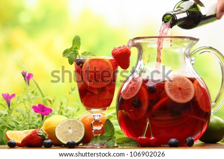 Refreshing sangria (punch) with fruits - stock photo