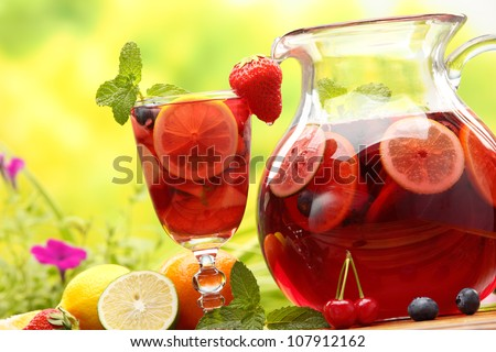 Refreshing sangria (punch) with fruits,Closeup. - stock photo