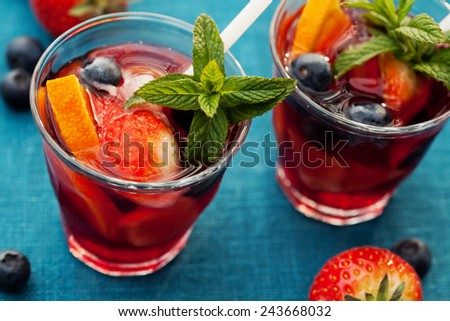 Refreshing sangria (punch) with fruits, picnic idea - stock photo