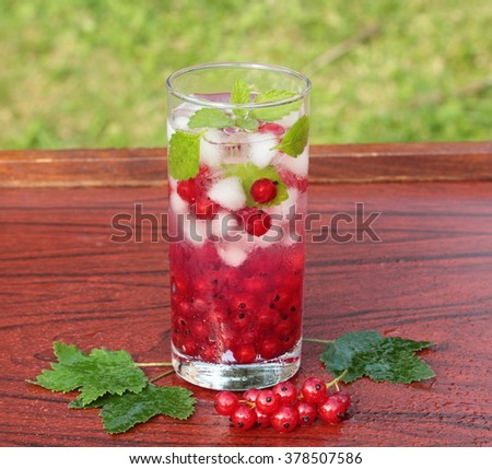 Refreshing summer drink with redcurrant and mint  - stock photo