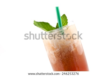 Refreshing thai iced tea garnished with fresh mint leaves - stock photo