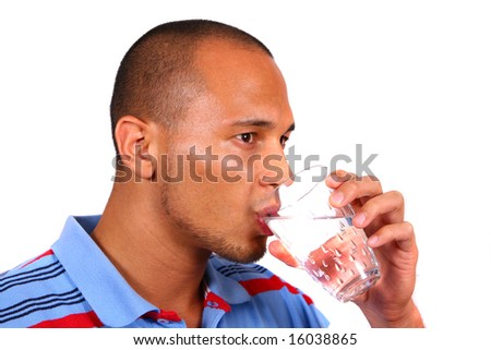 Refreshing Water Young man drinking water out of a glass. Isolated over white background.