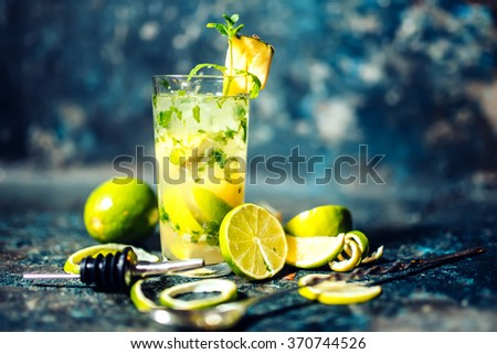 refreshment alcoholic cocktail drink at bar or pub. Gin and lime cocktail with pineapple and ice served cold by bartender