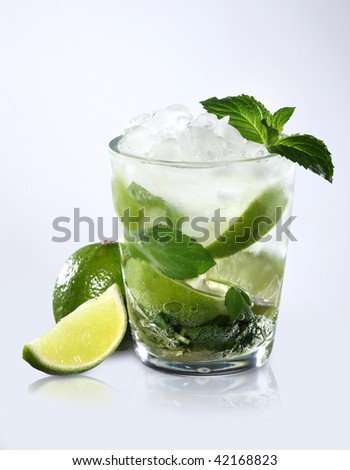 Refreshment cocktail with a slice of lemon - stock photo