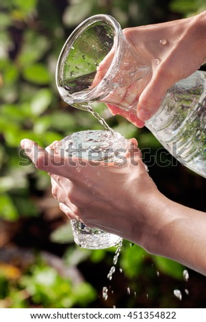 Refreshment pith a glass of water on a sunny, hot summer day. Water and thirst concept - stock photo