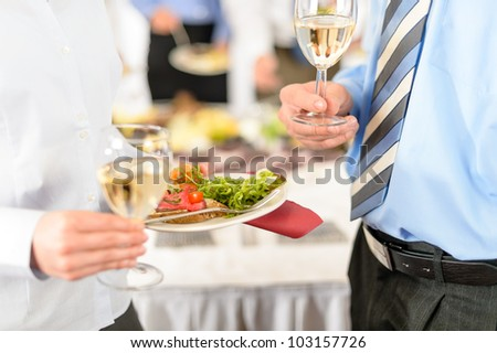 Refreshments at business meeting close-up appetizer plate and wine - stock photo