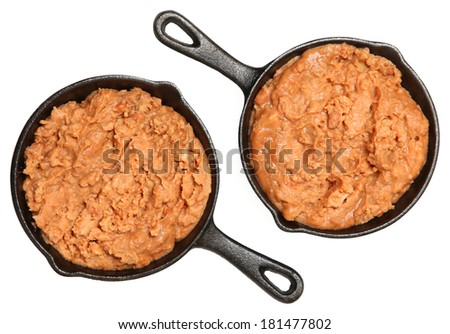 Refried Beans in Skillets Over White in Single Serve Skillets - stock photo