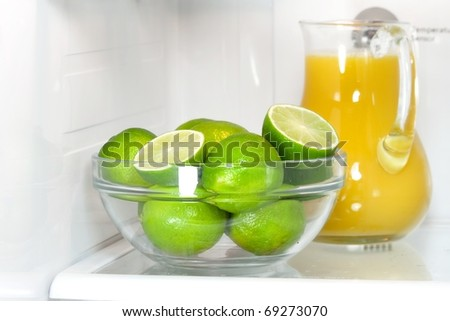 Refrigerator full with some kinds of food - orange juice, lime - stock photo